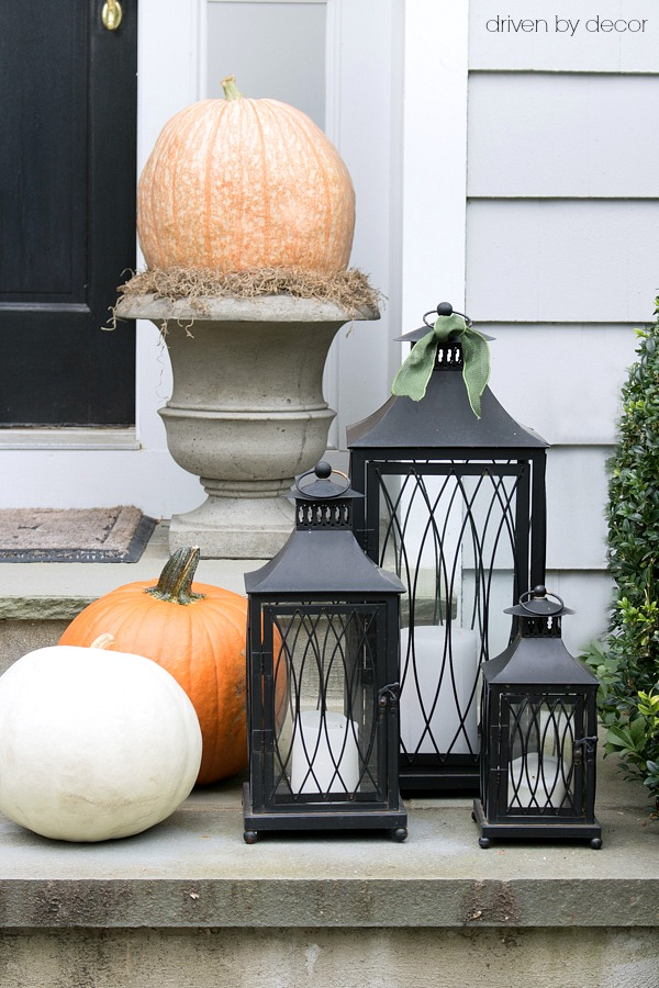 Simple front porch decorations - a trio of lanterns with pumpkins