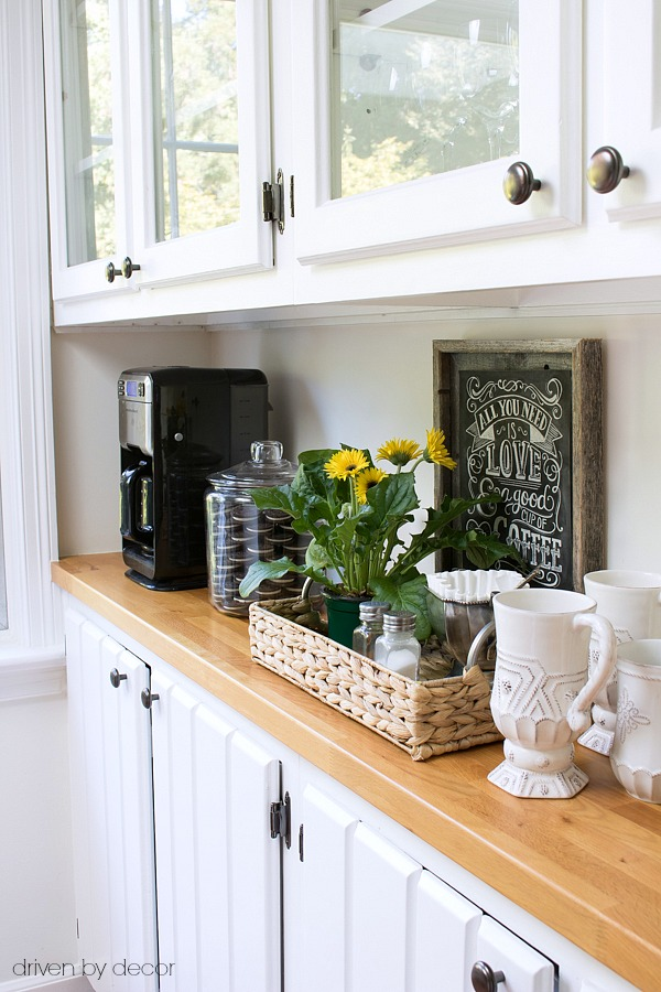 Simple kitchen coffee station with butcher block countertops