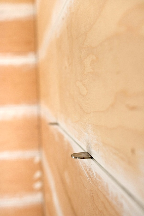 Use nickels as a spacer for DIY shiplap!