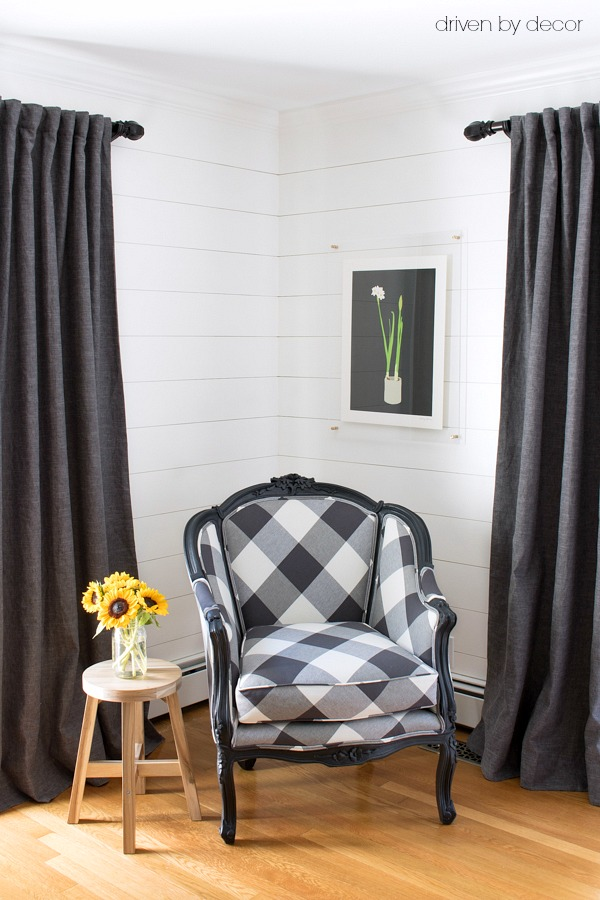 Vintage chair reupholstered in buffalo check on the diagonal and gray linen drapes