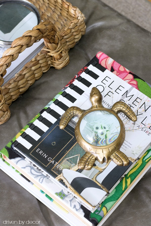 Wrap a book in fabric to add color to your coffee table