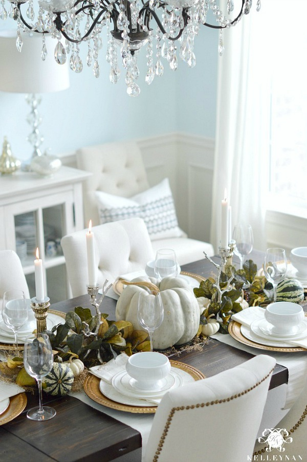 Fall table with pumpkins and green leaf garland - Kelley Nan