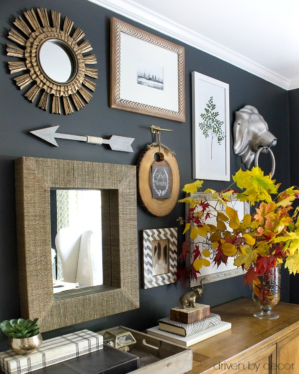 Office gallery wall with vase on console filled with fall branches