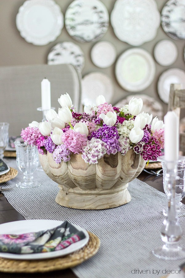 Scalloped wood bowl (linked in post!) used as a centerpiece for a spring table