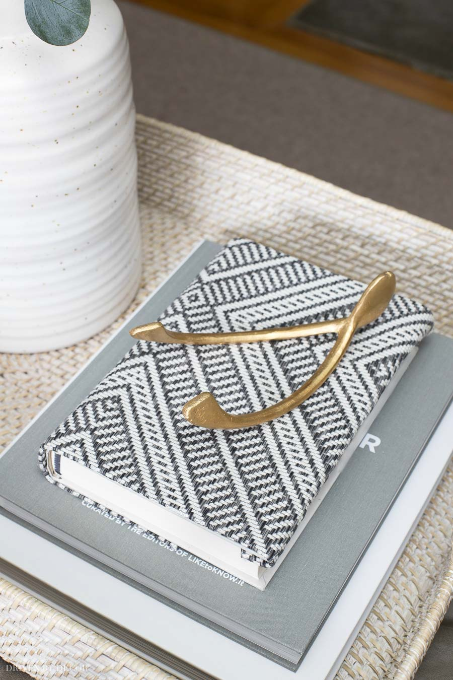 Love the idea of using a favorite fabric remnant to cover a book as part of your coffee table decor!