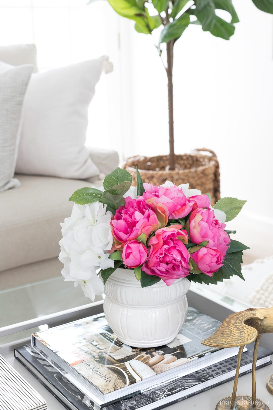 These faux peonies and hydrangeas in a simple white planter are beautiful as coffee table decor!
