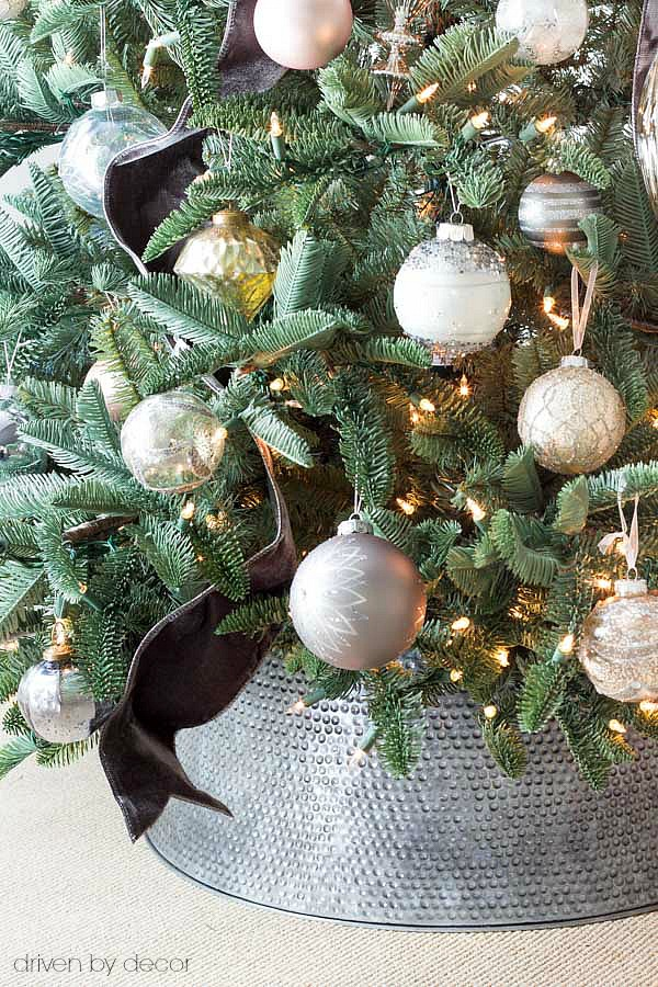 Love this metal tree collar used instead of a traditional Christmas tree skirt
