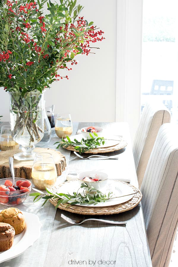 A simple holiday brunch tablesetting with boxwood branches for greenery