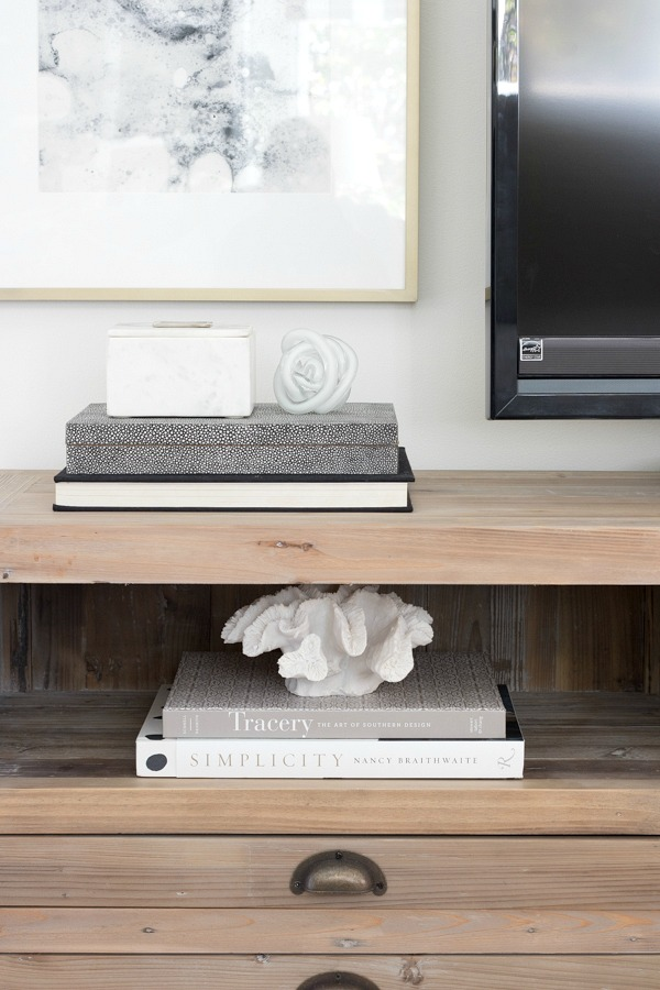 Books and accessories on media console