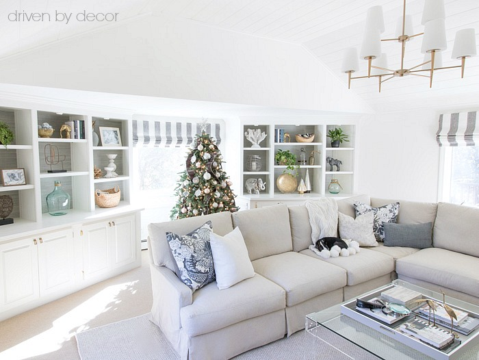 Family room with Christmas tree centered in front of the window