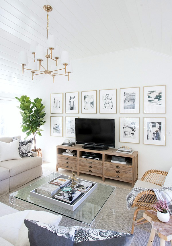 Family room with fabulous art wall around the TV
