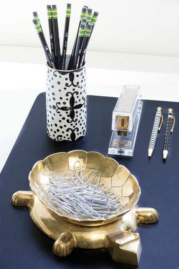 Fun desk accessories - gold stapler, Jill Rosemwald pencil holder, and brass turtle dish for paper clips