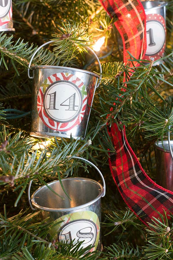 Mini galvanized buckets filled with goodies to use as a holiday advent calendar