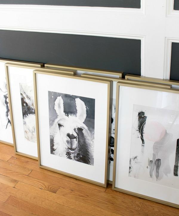 Minted art in matte brass frames