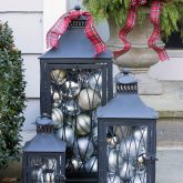 Ornament filled lanterns - perfect front porch holiday decor!