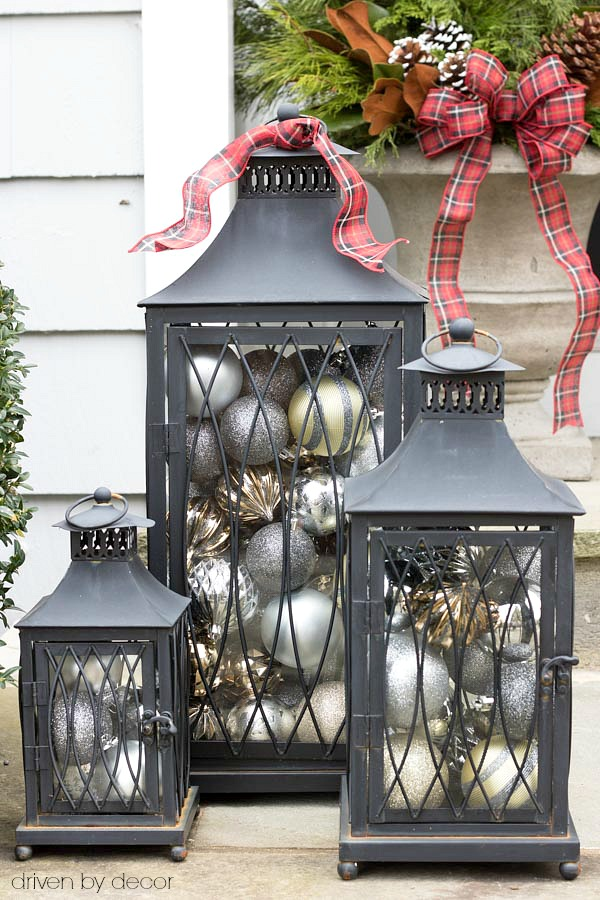 christmas home tour a set of lanterns filled with ornaments used as simple front porch