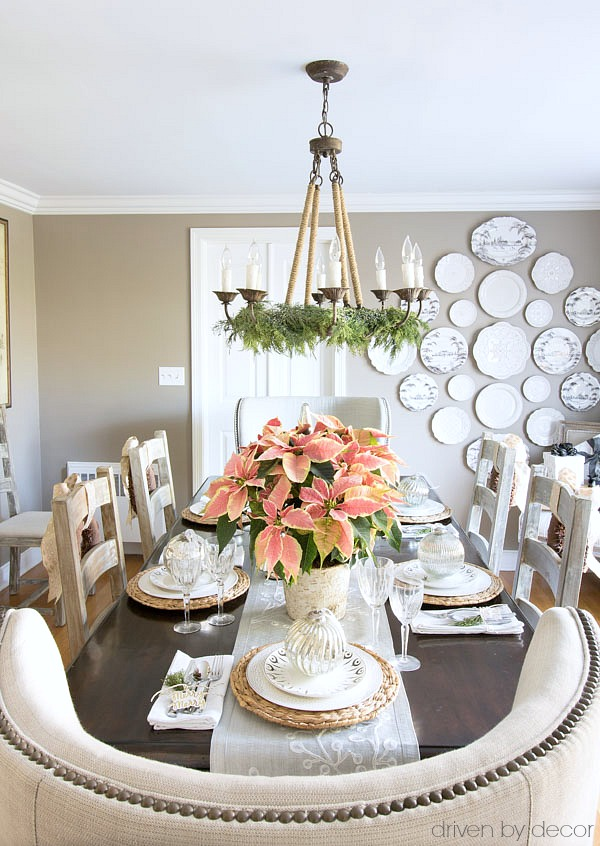 Christmas home tour - a simple table setting for Christmas with oversized ornaments at each plate