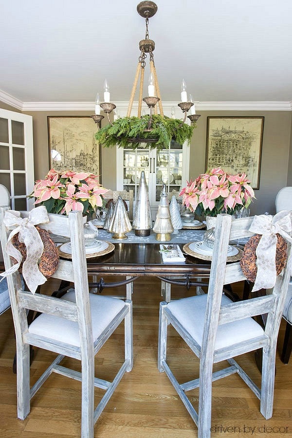 Christmas home tour - Christmas dining room decorated with gold and silver metallics and pink poinsettias
