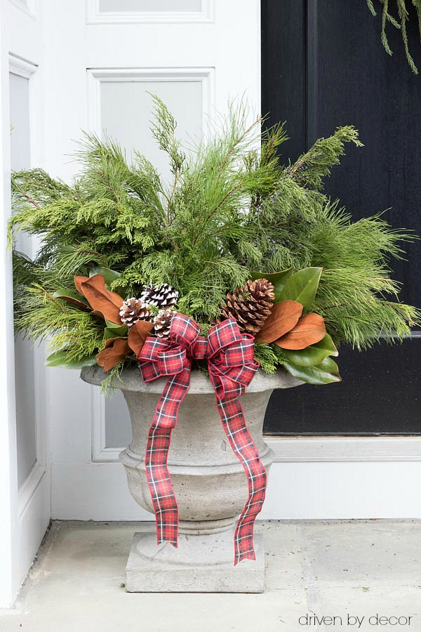 Christmas home tour - create festive Christmas / winter planters by adding greenery branches and pinecones to a pair of planters