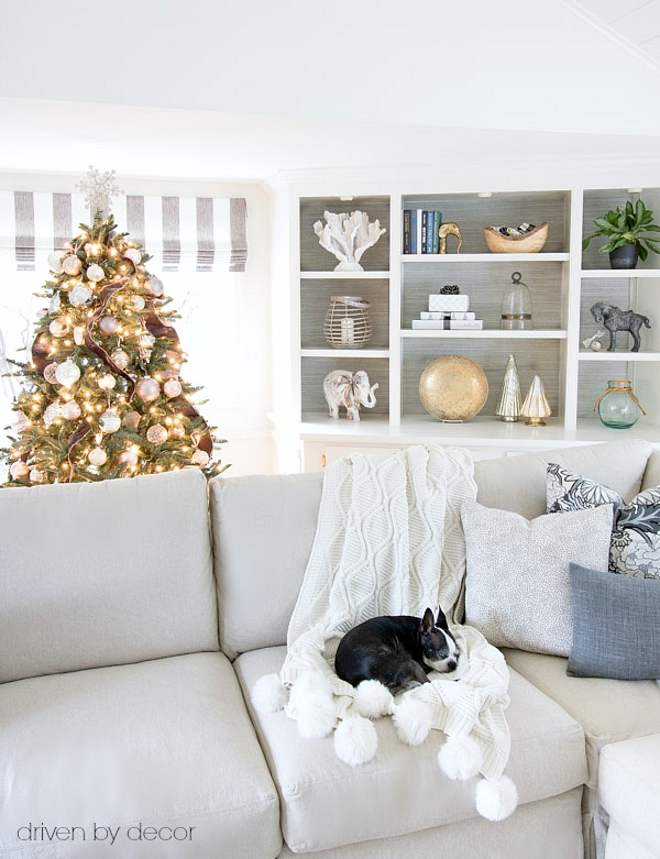 Loving the simple, warm and cozy Christmas touches added to this family room (especially the pom pom throw!)
