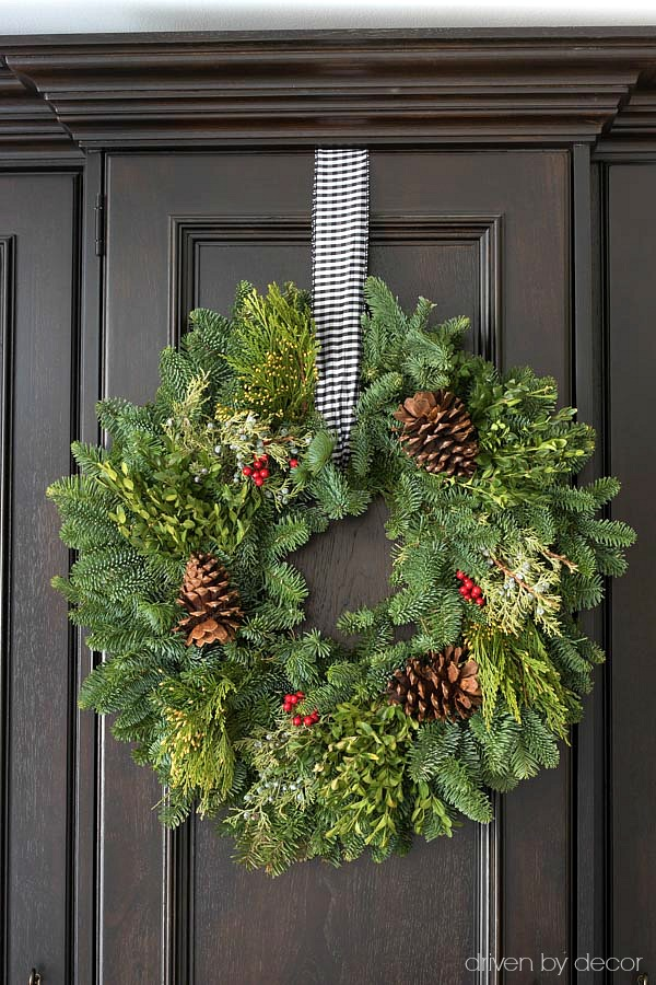 Gorgeous fresh Christmas wreath with pinecones and berries