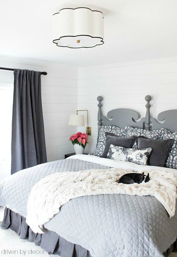 Welcoming bedroom in shades of gray with fur throw to cozy it up for winter!