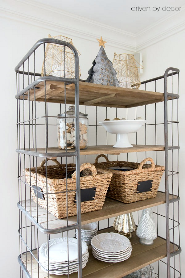Wire and wood bakers rack used for extra kitchen storage