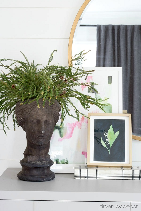 Fun planter head filled with evergreen branches for the holidays