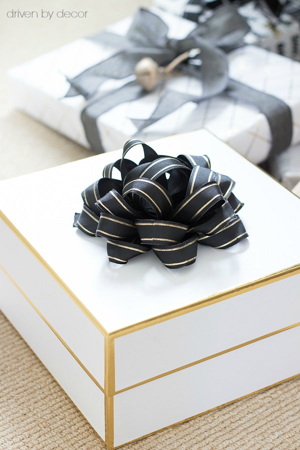 White and gold Target gift boxes and a black and gold bow