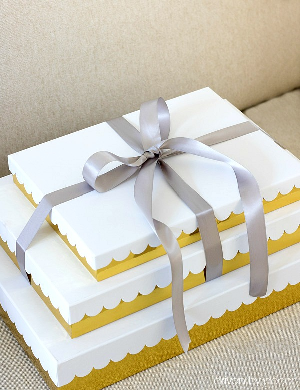Gold and white scalloped gift boxes tied with satin ribbon are a simple, beautiful way to wrap Christmas presents!