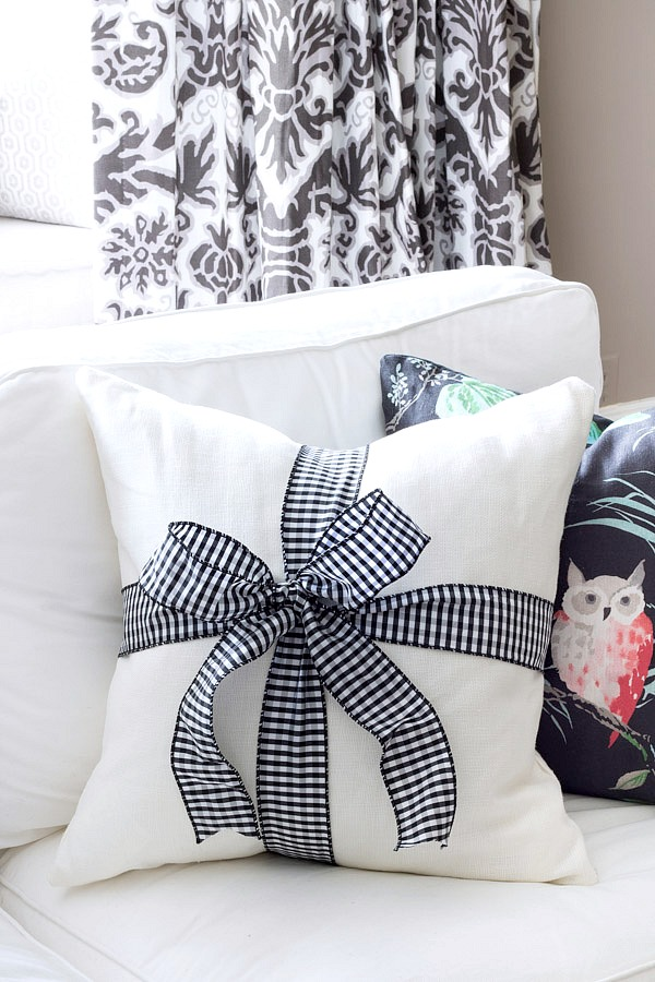 Smart idea to decorate for Christmas on the cheap - tie wired ribbon in a bow around a solid colored pillow