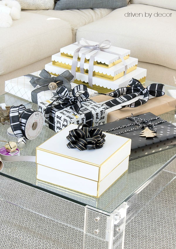 Christmas presents in black, white, and gold