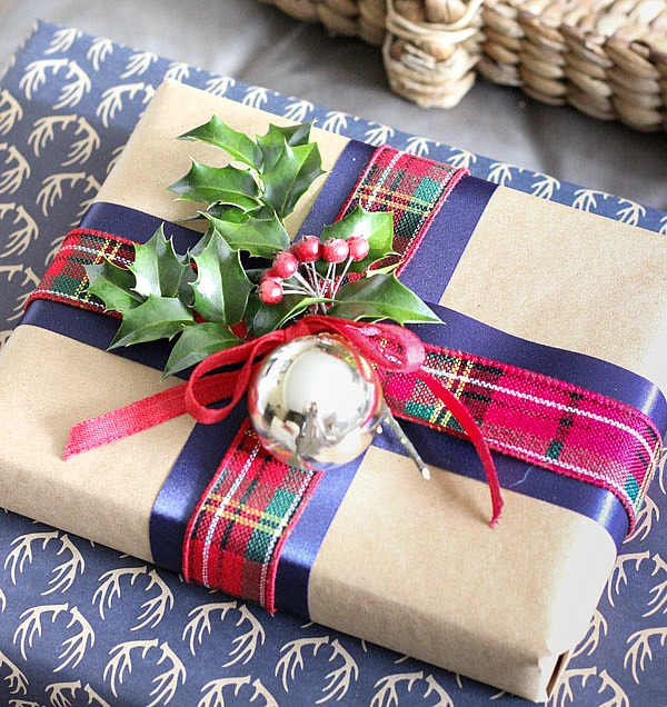 Layer different colors and designs of ribbon to dress up a present when wrapping for Christmas