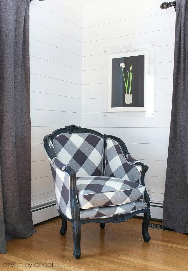 Black and white buffalo check chair and acrylic & brass frame
