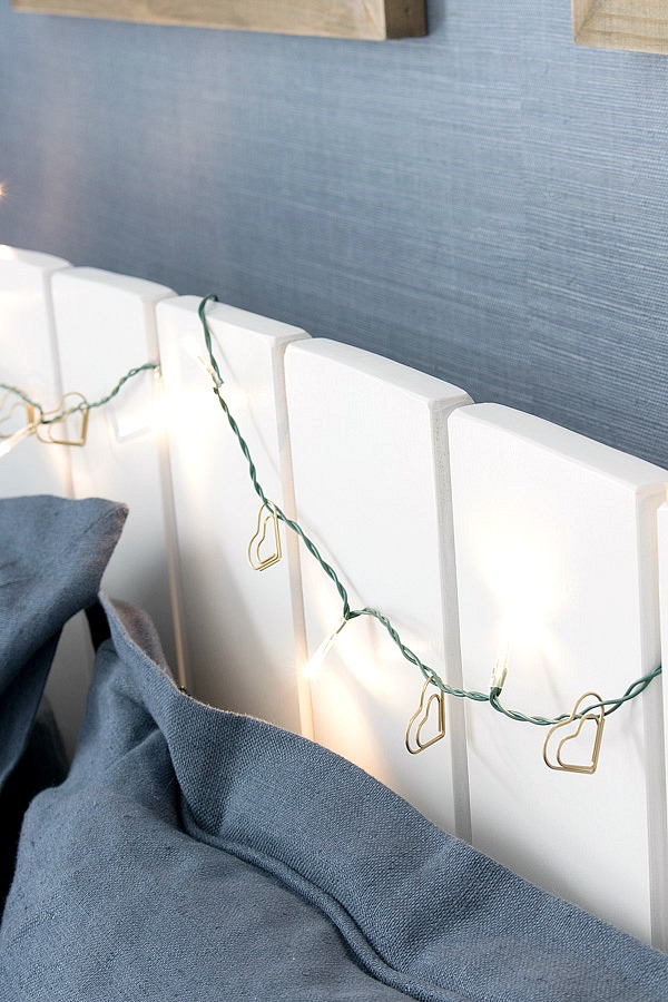 Gold paperclip hearts added to a strand of twinkle lights for a simple, sparkly Valentine's Day garland