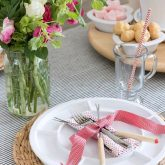 Fondue forks and Valentine's Day napkin tied with ribbon for a simple fondue feast placesetting!