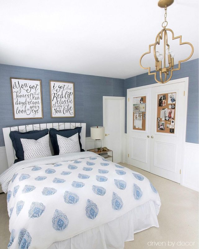 Blue and white teen room with cork board closet doors