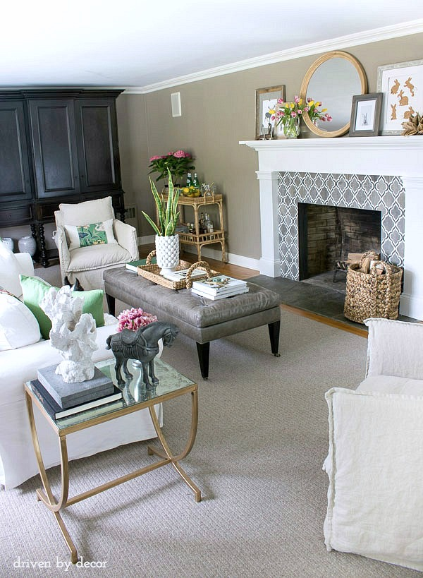 Living room decorated in neutrals with pops of color for spring