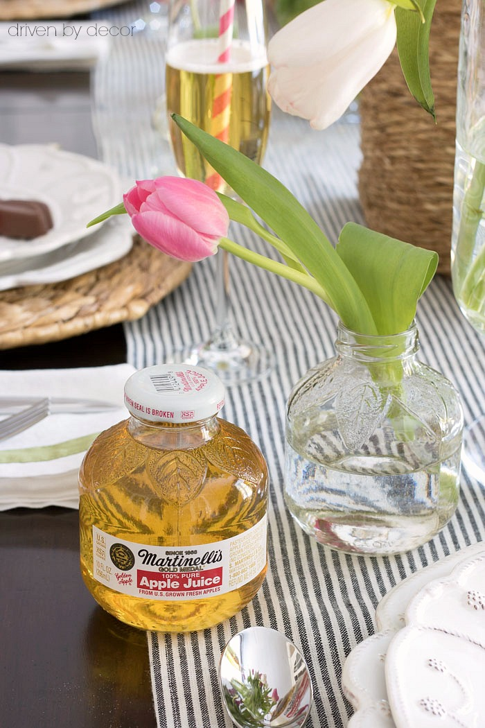 The CUTEST little vases that are actually single serve apple juice bottles with the label soaked off!