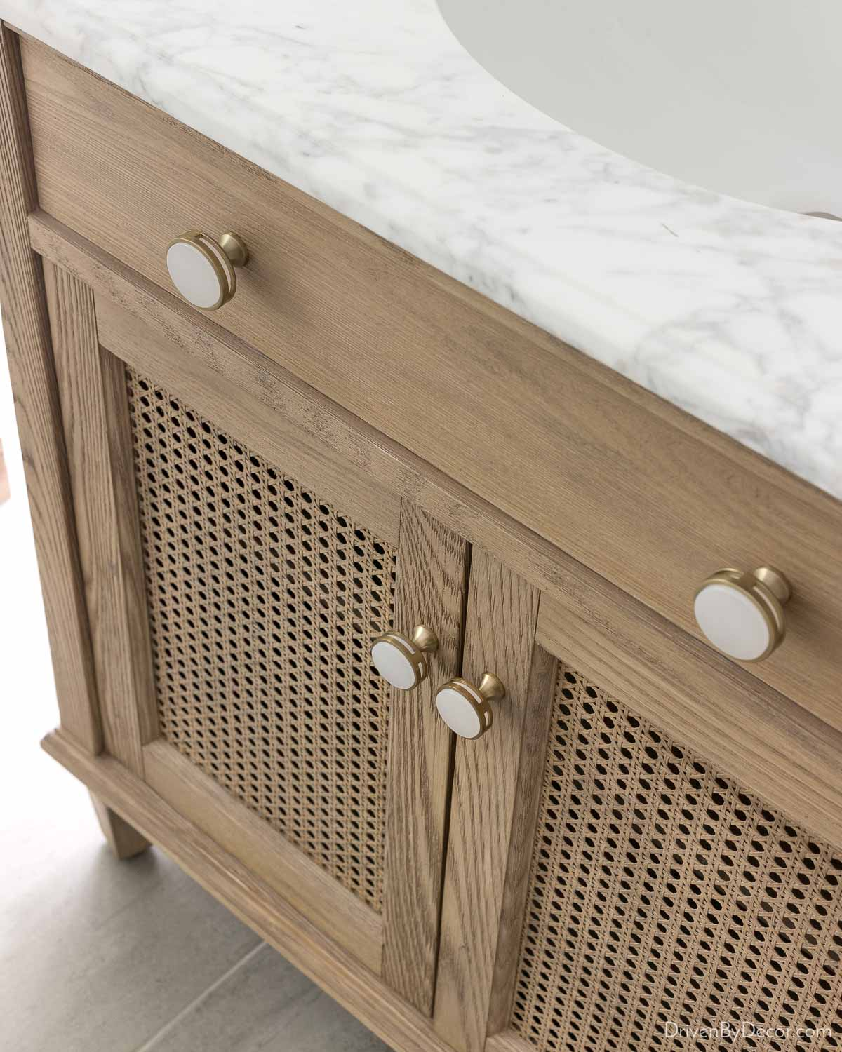 Love these acrylic and gold knobs for bathroom cabinets!