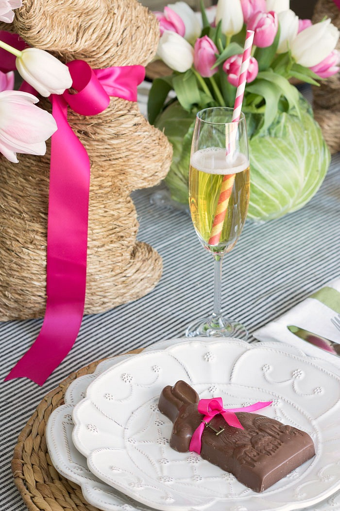 Looking for an Easter table decoration idea? Tie a decorative letter onto a chocolate bunny for an edible Easter place card!
