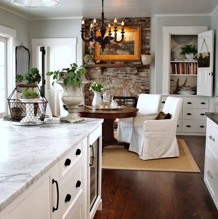 Gorgeous breakfast nook with brick fireplace - For the Love of a House