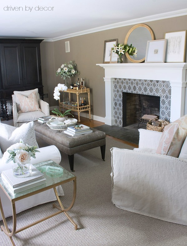 Family room in neutrals with blush pillows and flowers for spring