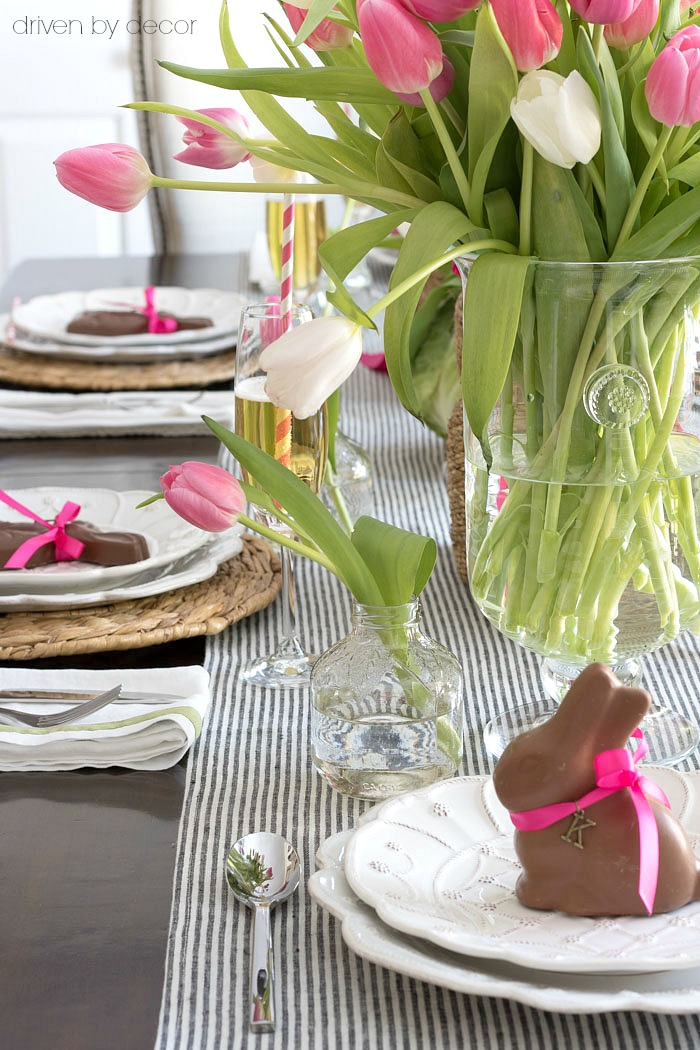 Use a mini apple juice bottle as a small vase for decorating your Easter table - love this idea!