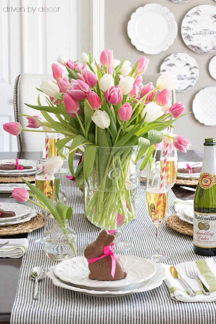 The perfect simple spring table decorations including vases of tulips and chocolate bunnies at each plate!
