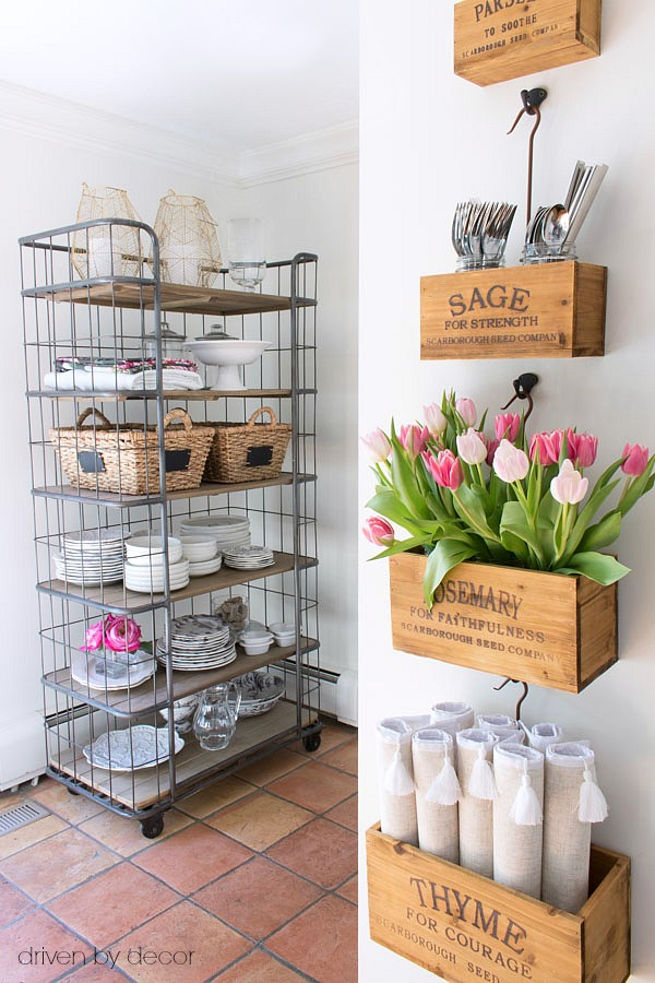 A baker's rack adds extra storage space in the kitchen and wall-mounted crates keep tabletop necessities close at hand