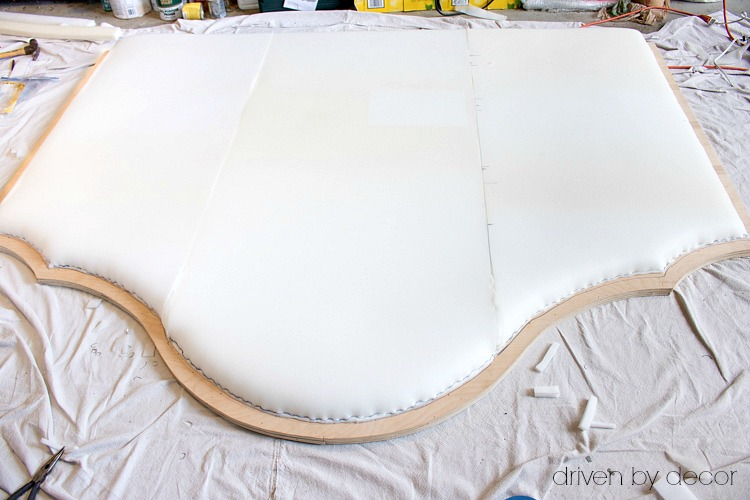 Foam stapled to plywood in preparation for upholstering and adding nailheads