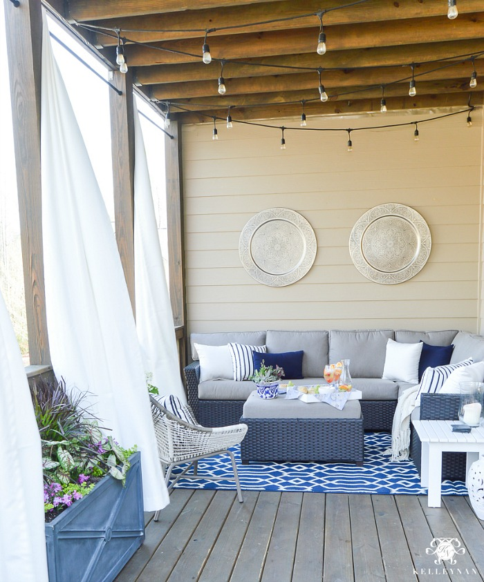 Love these gold medallions hung on this wall in this gorgeous outdoor space by Kelley Nan