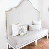 DIY upholstered kitchen banquette with nailhead trim - post includes full tutorial!