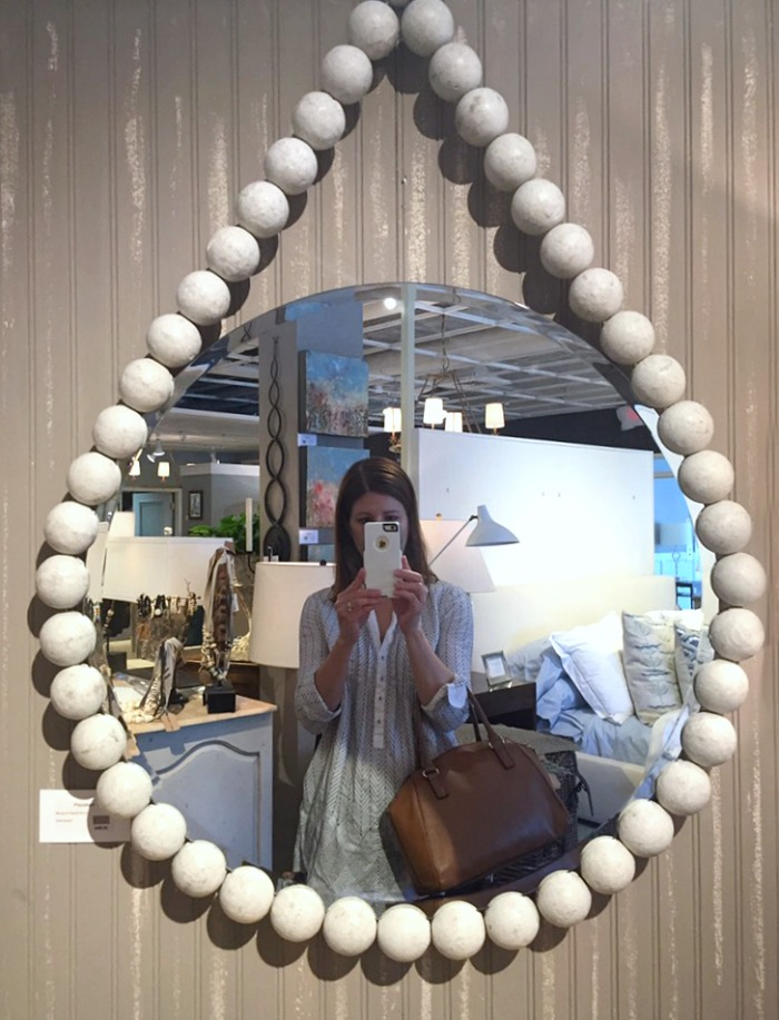 Round mirror surrounded by large wood beads - love!